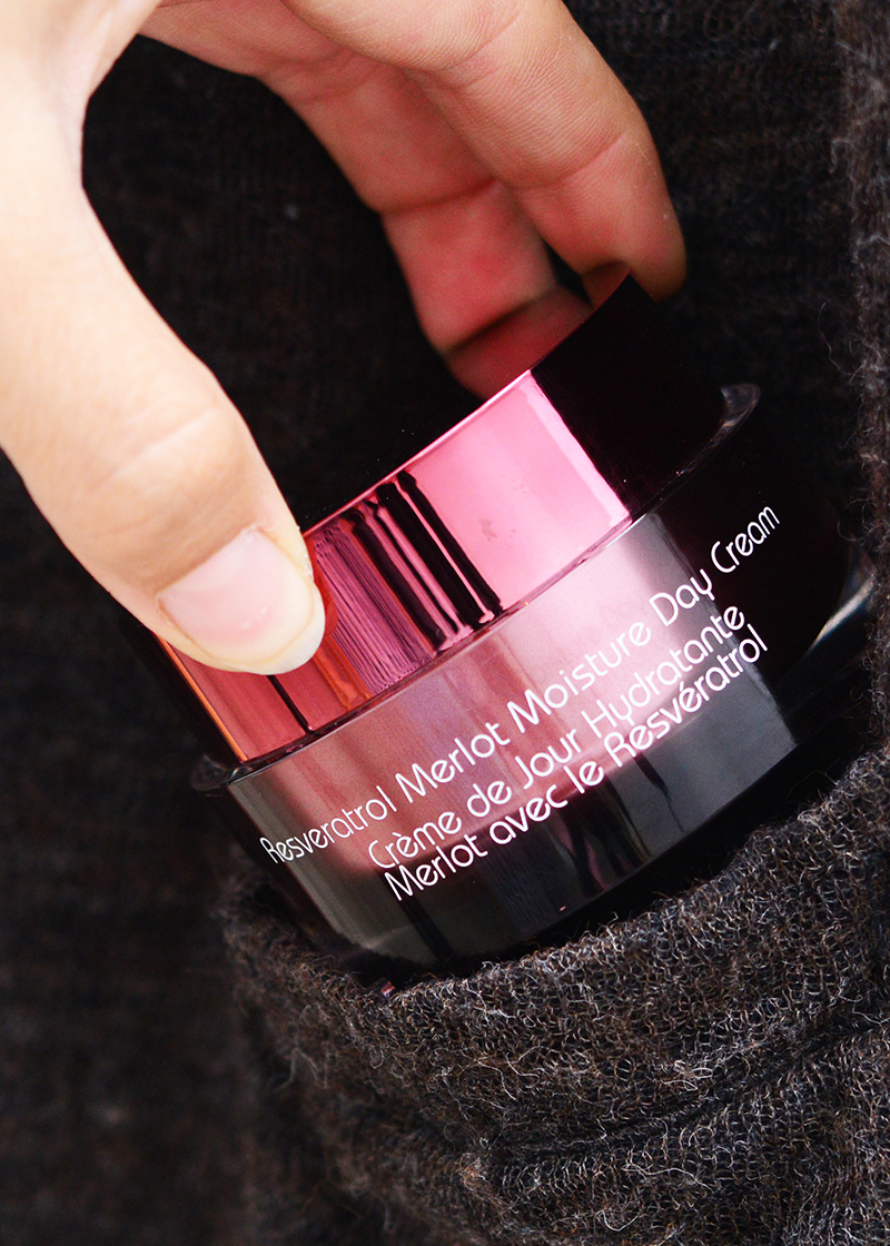 Moisture Day Cream being out into a pocket