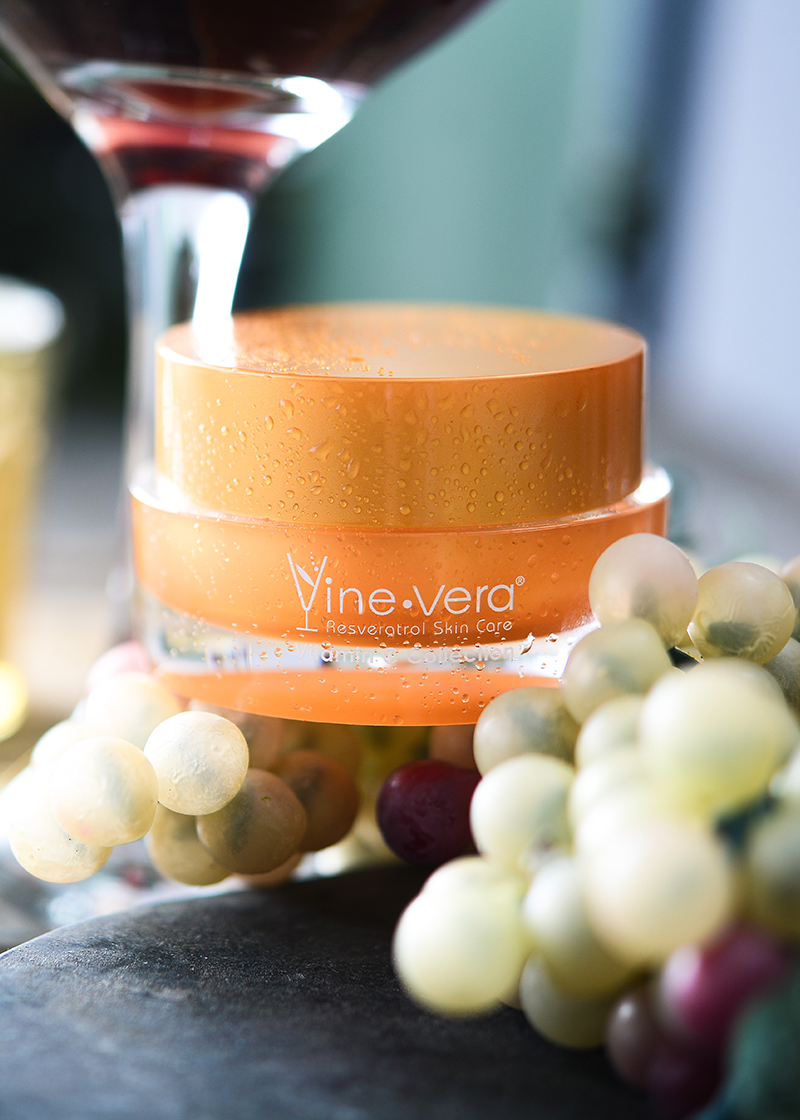 Resveratrol Vitamin C Lip Balm with a wine background