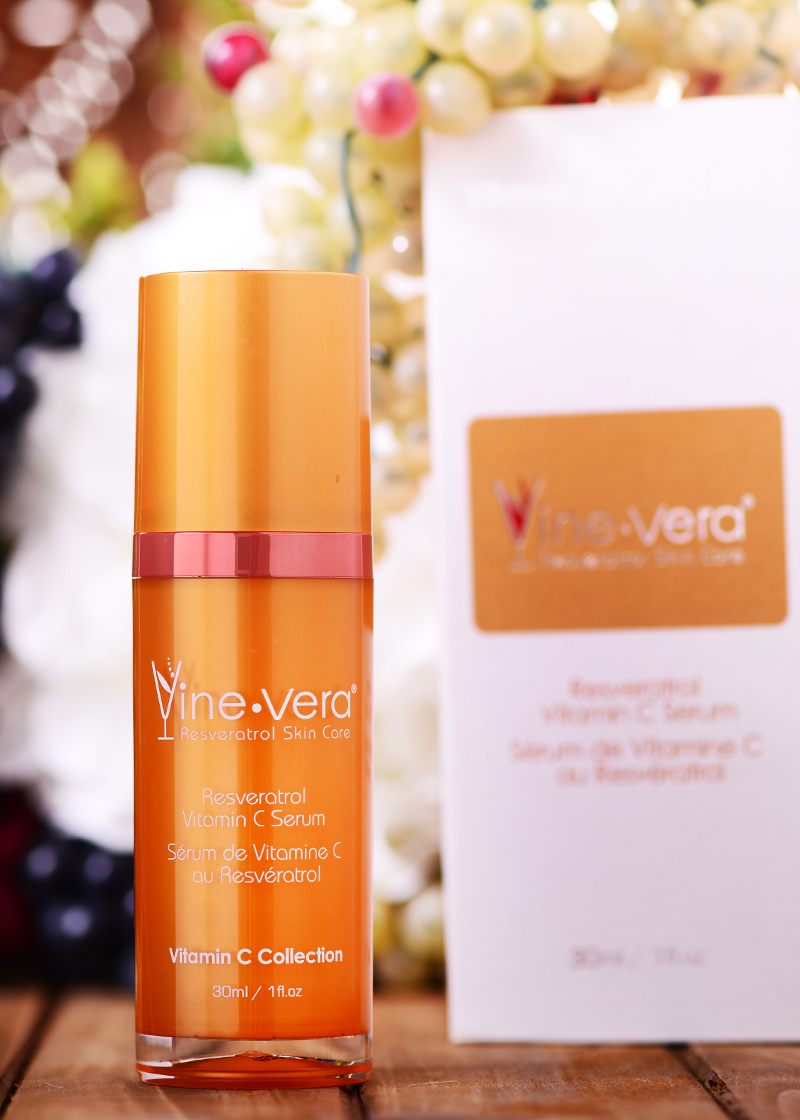 Resveratrol Vitamin C Serum with a background